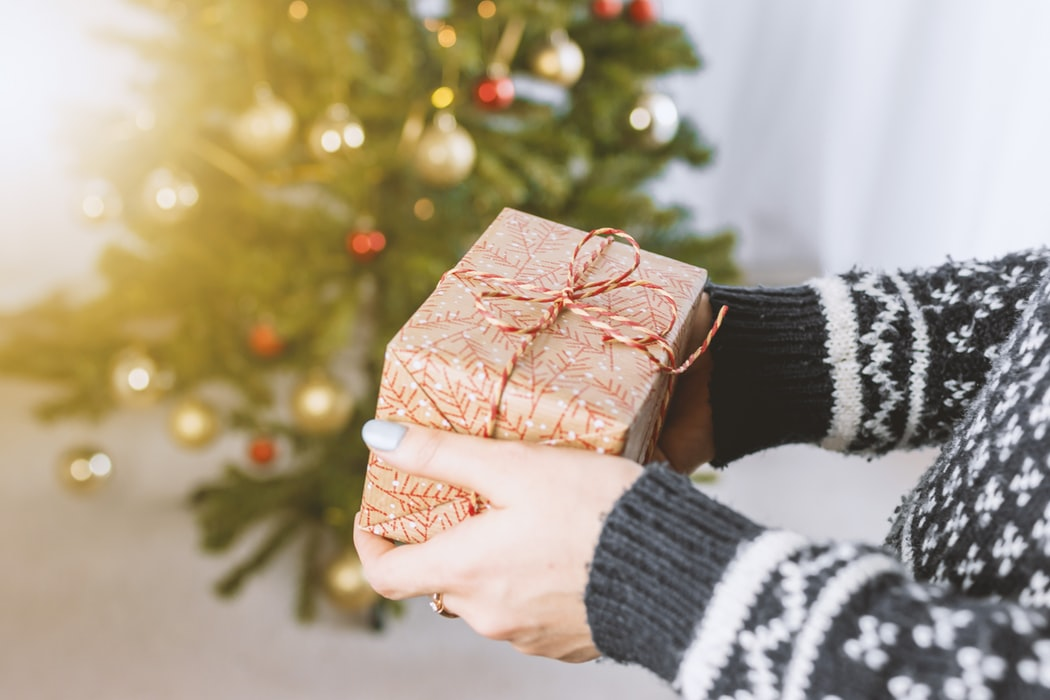 person holding christmas present