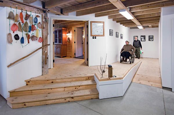 Indoor of home with ramp and person in wheelchair