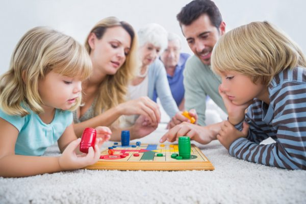 family playing a board game in the living room