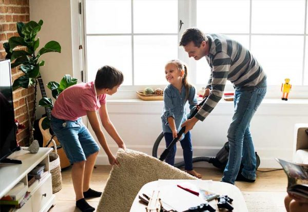 a dad teaching his kids how to clean