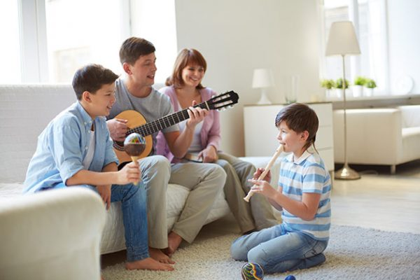 a family playing instruments and singing together in the livingroom